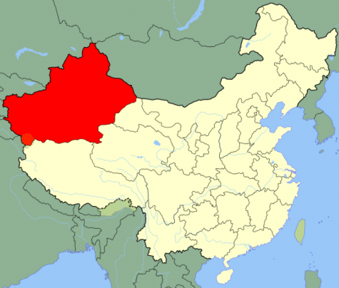 Xinjiang Uyghur Autonomous Region (in red.)  Image from Wikipedia with Creative Commons permission.